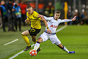Tottenham Hotspur midfielder Harry Winks (8) tackles Borussia Dortmund forward Marius Wolf (27) during the Champions League round of 16, leg 2 of 2 match between Borussia Dortmund and Tottenham Hotspur at Signal Iduna Park, Dortmund, Germany on 5 March 2019.