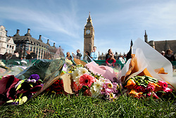 UK ENGLAND LONDON 25MAR17 - Floral tributes are laid in Parliament Square for the victims of Wednesday's terror attack. Four people were killed after the assailant, Khalid Masood mowed down pedestrians on Westminster Bridge and crashed into parliament's gates.<br /> <br /> <br /> jre/Photo by Jiri Rezac<br /> <br /> © Jiri Rezac 2017