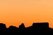 The peaks and buttes that make up the Wild Horse Mesa in Arizona are turned to silhouette at sunrise.
