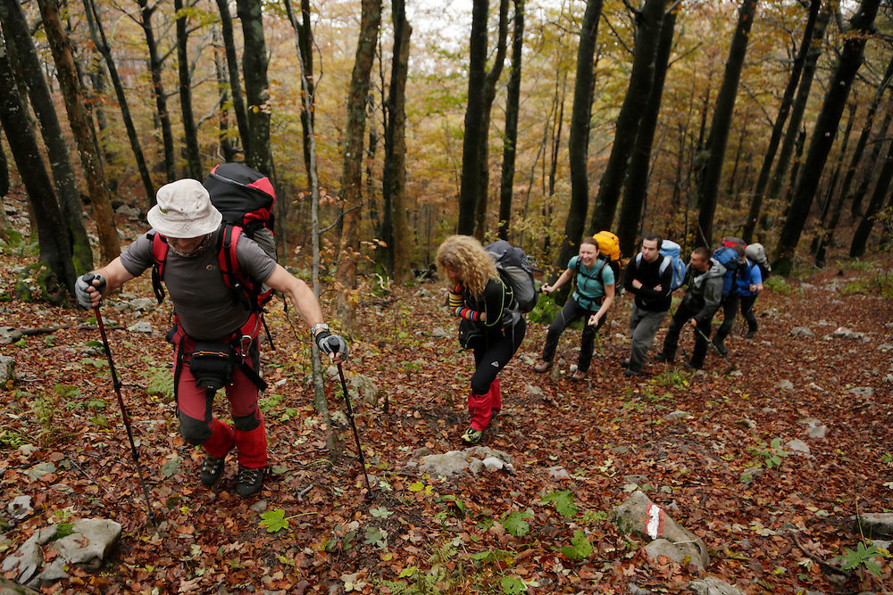 Via Dinarica team in the forest, on the approach to the summit of Snjeznik, Risnjak National Park, Gorski Kotar, Croatia.