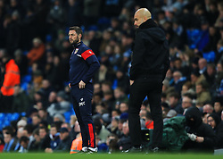 Bristol City assistant coach Jamie McAllister and Manchester City manager Pep Guardiola - Mandatory by-line: Matt McNulty/JMP - 09/01/2018 - FOOTBALL - Etihad Stadium - Manchester, England - Manchester City v Bristol City - Carabao Cup Semi-Final First Leg