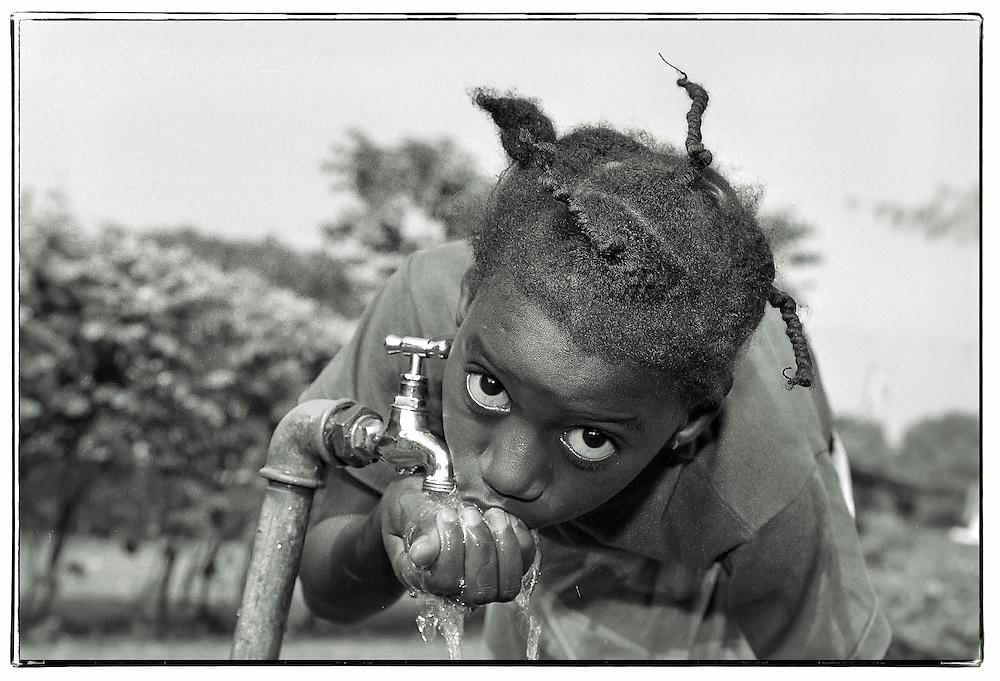Water is so precious. street portrait, Guinea Conakry