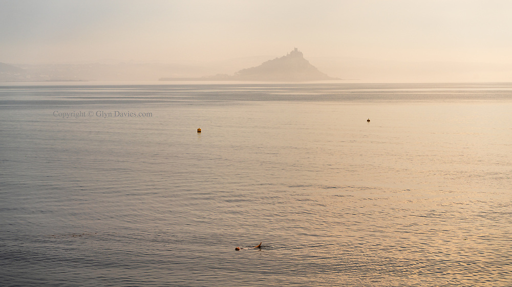 As the early morning fog lifted, leaving a gentle mist, a lady quietly entered the sea and swam offshore, to a point where she just floated on her back and looked up at the day ahead.