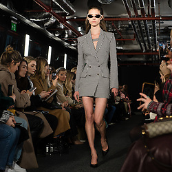 © Licensed to London News Pictures. 15/02/2020. London, UK.  London Fashion Week Fall Winter 2020 - David Koma runway show at The Leadenhall Building - model on the catwalk.  Photo credit : Richard Isaac/LNP