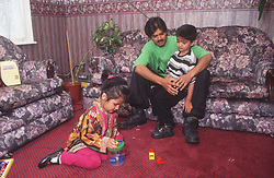 Father and children in sitting room,