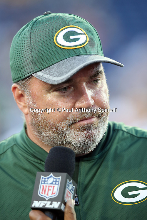 Green Bay Packers head coach Mike McCarthy is interviewed about the cancellation of the 2016 NFL Pro Football Hall of Fame preseason football game against the Indianapolis Colts on Sunday, Aug. 7, 2016 in Canton, Ohio. The game was canceled for player safety reasons due to the condition of the paint on the turf field. (©Paul Anthony Spinelli)