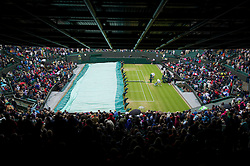 LONDON, ENGLAND - Monday, July 2, 2012: The covers come on as rain stops play during the Gentlemen's Singles 4th Round match on day seven of the Wimbledon Lawn Tennis Championships at the All England Lawn Tennis and Croquet Club. (Pic by David Rawcliffe/Propaganda)