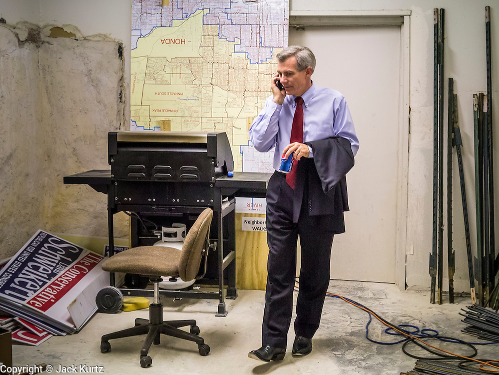 28 AUGUST 2012 - PHOENIX, AZ:  Rep. DAVID SCHWEIKERT (R-AZ) takes a cell phone call at his victory party Tuesday night. Schweikert faced Congressman Ben Quayle in what was the hardest Republican primary election in Arizona in 2012. Both were incumbent Republican freshmen elected to Congress from neighboring districts in 2010. They ended up in the same district at the end of the redistricting process and faced off against each other in the primary to represent Arizona's 6th Congressional District, which is made up of Scottsdale, Paradise Valley and parts of Phoenix. The district is solidly Republican and the winner of the primary is widely expected to win November's general election. Both are conservative Republicans with Tea Party backing.   PHOTO BY JACK KURTZ