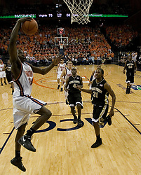 Virginia's Mamadi Diane (24) delivers a dunk against Wake Forest.  The Virginia Cavaliers defeated the Wake Forest Demon Decons 88-76 at the John Paul Jones Arena in Charlottesville, VA on January 21, 2007.