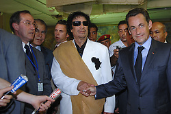 File photo - Libya's President Moammar Gadhafi (L) greets his French counterpart Nicolas Sarkozy and Claude Gueant at Bab Azizia Palace in Tripoli, Libya on July 25, 2007. Sarkozy met Gadhafi on Wednesday on a trip to deepen relations after helping to resolve a diplomatic standoff that hurt the oil exporter's ties with the West. Former French President Nicolas Sarkozy was in police custody on Tuesday morning March 20, 2018, an official in the country's judiciary said. He was to be questioned as part of an investigation into suspected irregularities over his election campaign financing, the same source added. The probe related to alleged Libyan funding for Sarkozy's 2007 campaign, Le Monde newspaper reported. Photo by Christophe Guibbaud/ABACAPRESS.COM