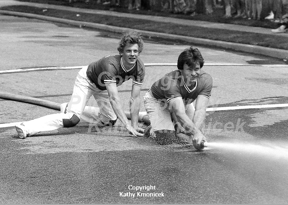 The Hempstead Fire Department Yellow Hornets racing team in action in 1981.<br />  &copy; Photography by Kathy Kmonicek