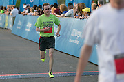Matt Martina finishes at the Corporate Challenge on the campus of RIT on Tuesday, May 24, 2016.