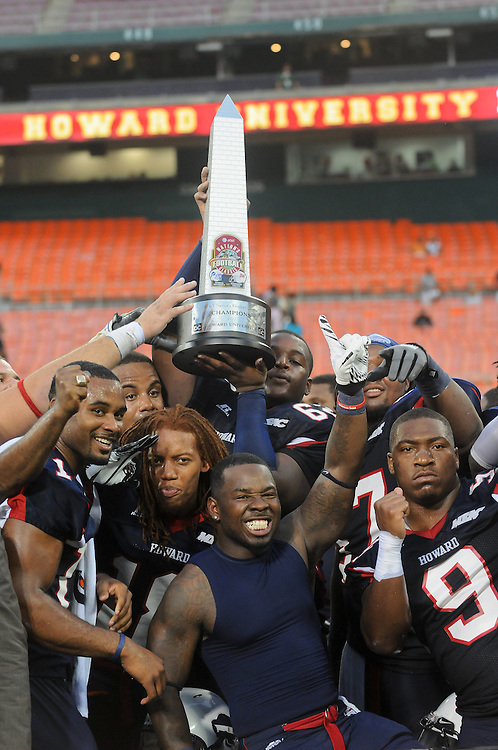 Washington DC--Members of the Howard University football team celebrate by lifting the trophy after winning the AT&T Nation's Football Classic Saturday afternoon at RFK Stadium, beating Morehouse College 30-29 with a come from behind touchdown with less than a minute left in the game. (Photo by Alan Lessig)