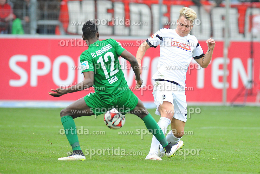 21.03.2015, Schwarzwald Stadion, Freiburg, GER, 1. FBL, SC Freiburg vs FC Augsburg, 26. Runde, im Bild (l.) Abdul Rahman Baba (FC Augsburg) im Zweikampf, Aktion, mit (r.) Felix Klaus (SC Freiburg) // during the German Bundesliga 26th round match between SC Freiburg and FC Augsburg at the Schwarzwald Stadion in Freiburg, Germany on 2015/03/21. EXPA Pictures &copy; 2015, PhotoCredit: EXPA/ Eibner-Pressefoto/ Laegler<br /> <br /> *****ATTENTION - OUT of GER*****
