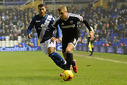 Brentford defender Jake Bidwell gets away from Birmingham City midfielder David Davis during the Sky Bet Championship match between Birmingham City and Brentford at St Andrews, Birmingham, England on 2 January 2016. Photo by Alan Franklin.
