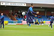 AFC Wimbledon defender Nesta Guinness-Walker (18) warming up during the EFL Sky Bet League 1 match between AFC Wimbledon and Rochdale at the Cherry Red Records Stadium, Kingston, England on 5 October 2019.
