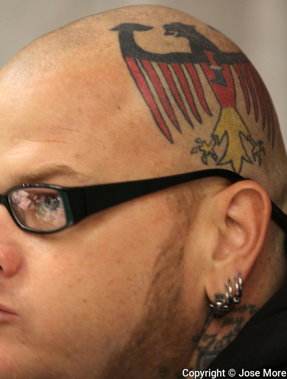 &quot;Hillbilly&quot; from Jacksonville, Florida sports his head tattoo and earrings on his T-shirt booth at the 18th Annual South Florida Tattoo Expo<br />