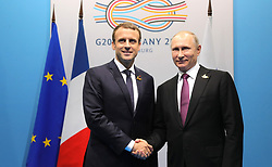July 8, 2017 - Hamburg, Germany - Russian President Vladimir Putin, right, shakes hands with French President Emmanuel Macron prior to the start of their bilateral meeting on the sidelines of G20 Summit meeting July 8, 2017 in Hamburg, Germany. (Credit Image: © Michael Klimentyev/Planet Pix via ZUMA Wire)