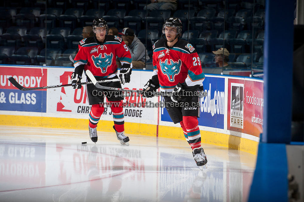 KELOWNA, CANADA - OCTOBER 11:  Colton Heffley #25 and Dalton Yorke #4 of the Kelowna Rockets warm up on the ice on October 11, 2013 at Prospera Place in Kelowna, British Columbia, Canada (Photo by Marissa Baecker/Shoot the Breeze) *** Local Caption ***
