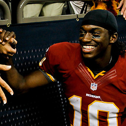 September 9, 2012; New Orleans, LA, USA; Washington Redskins quarterback Robert Griffin III (10) celebrate with fans following a win over the New Orleans Saints at the Mercedes-Benz Superdome. The Redskins defeated the Saints 40-32. Mandatory Credit: Derick E. Hingle-USA TODAY SPORTS