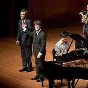 August 8, 2011 - Manhattan, NY : Pianist Peter Serkin, far left, conductor Pablo Heras-Casadoand, second from left, and the International Contemporary Ensemble acknowledge the audience after performing Stravinsky's 'Concerto for Piano and Winds 1923-24' during Lincoln Center's Mostly Mozart festival at Alice Tully Hall on Monday evening. CREDIT: Karsten Moran for The New York Times
