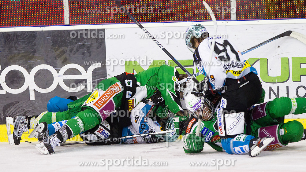 Brock McBride (HDD Tilia Olimpija, #10) and Martin Grabher Meier (EHC Liwest Linz, #91) and behind Brad Cole (HDD Tilia Olimpija, #2) vs Danny Irmen (EHC Liwest Linz, #9) during ice-hockey match between HDD Tilia Olimpija and EHC Liwest Black Wings Linz at fourth match in Semifinal  of EBEL league, on March 13, 2012 at Hala Tivoli, Ljubljana, Slovenia. (Photo By Matic Klansek Velej / Sportida)