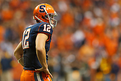 Oct 21, 2011; Syracuse NY, USA;  Syracuse Orange quarterback Ryan Nassib (12) before a play against the West Virginia Mountaineers during the fourth quarter at the Carrier Dome.  Syracuse defeated West Virginia 49-23. Mandatory Credit: Jason O. Watson-US PRESSWIRE