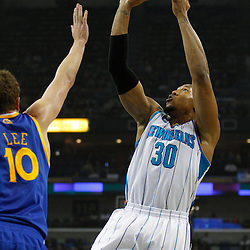 January 5, 2011; New Orleans, LA, USA; New Orleans Hornets power forward David West (30) shoots over Golden State Warriors center David Lee (10)during the first half at the New Orleans Arena.   Mandatory Credit: Derick E. Hingle