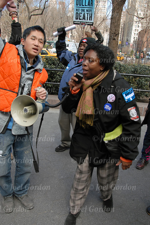 African American woman with mike and bullhorn leading group. .Domestic Workers United for Bill of Rights for the protection and respect for the over 200,000 nannies, housekeepers and elderly companions in the metropolitan area supporting the antil-war protest. Join hands symbolize unity in the call for peace in River to River Join Hands For Peace on 3/22/08. Hands Across 14th Street from 11th Ave to Ave A.  After 5 years of war to bring all the troops home now.