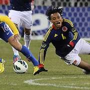 Juan Guillermo Cuadrado, Colombia, is challenged by Fabio Santos, Brazil, during the Brazil V Colombia International friendly football match at MetLife Stadium, New Jersey. USA. 14th November 2012. Photo Tim Clayton