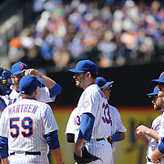 Pitcher Matt Harvey, New York Mets,  has a visit to the mound during the New York Mets Vs Miami Marlins MLB regular season baseball game at Citi Field, Queens, New York. USA. 19th April 2015. Photo Tim Clayton