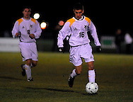 19 NOV. 2020 -- FENTON, Mo. -- St. John Vianney High School soccer player Jason Hackett (16) pushes the ball upfield during the Griffins game against St. Louis University High School during the MSHSA Class 3 state soccer semifinal at the A-B Center in Fenton, Mo. Friday, Nov. 19, 2010. Vianney topped SLUH 2-0 to advance to the state title game on Saturday.  Image © copyright 2010 Sid Hastings.