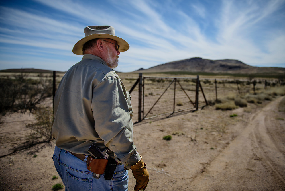rer031617h/A1/03.16.17/Roberto E. Rosales<br /> William Hurt(Cq) is a private landowner and leaseholder who lives, ranches and farms along the U.S.-Mexico border in New Mexico's bootheel area. Hurt feels he should be consulted before any construction of a wall would be built on his land.  Pictured is Williman Hurt (Cq) standing at the border fence on his property.<br /> Hachita New Mexico. <br /> ( Roberto E. Rosales/Albuquerque Journal.)