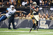 NEW ORLEANS, LA - NOVEMBER 8:  Brandin Cooks #10 of the New Orleans Saints catches a pass for a touchdown over Perrish Cox #29 of the Tennessee Titans at Mercedes-Benz Superdome on November 8, 2015 in New Orleans, Louisiana.  The Titans defeated the Saints in overtime 34-28.  (Photo by Wesley Hitt/Getty Images) *** Local Caption *** Brandin Cooks; Perrish Cox