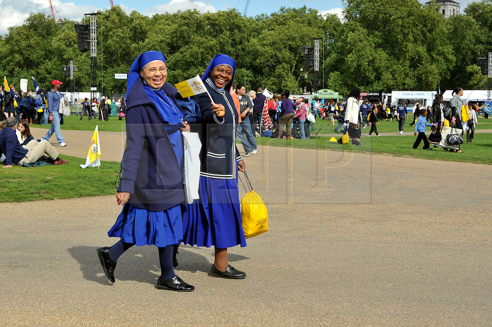 CENTRAL LONDON. Two nuns wave at the camera. Crowds of Londoners, visitors and pilgrims visit Hyde Park,London, for the visit of Pope Benedict XVI on 17/18th September 2010. It is estimated that 80,000 people will flock to see the Pontiff during his visit to the capital. 18th September 2010.STEPHEN SIMPSON.
