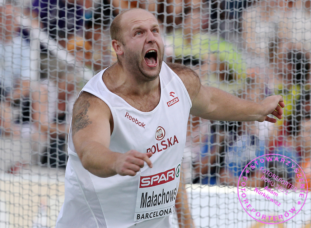 PIOTR MALACHOWSKI (POLAND) COMPETES IN THE MEN'S DISCUS FINAL DURING THE 2010 EUROPEAN ATHLETICS CHAMPIONSHIPS AT OLYMPIC STADIUM IN BARCELONA, SPAIN...SPAIN , BARCELONA , AUGUST 1, 2010..( PHOTO BY ADAM NURKIEWICZ / MEDIASPORT )..PICTURE ALSO AVAIBLE IN RAW OR TIFF FORMAT ON SPECIAL REQUEST.