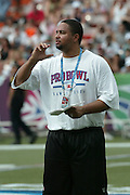 HONOLULU, HI - FEBRUARY 8:  A member of the AFC coaching staff oversees player practice prior to the 2004 NFL Pro Bowl game against the NFC at Aloha Stadium on February 8, 2004 in Honolulu, Hawaii. The NFC defeated the AFC 55-52. ©Paul Spinelli/SpinPhotos
