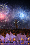 Fireworks fill the skies over the Khalifa Stadium in Doha as dancers perform during the Opening Ceremony of the Asian Cup 2011 football tournament held in The State of Qatar