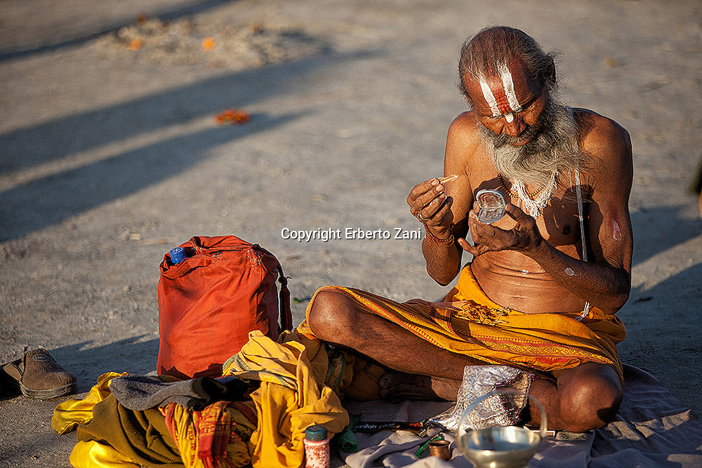 Kumbh Mela is one of the largest human congregations of faith on the Earth. Legend has it that in the mythological times, during a waging war between the demigods and demons for the possession of elixir of eternal life, a few drops of it had fallen on to four places that are today known as Prayag (Allahabad), Haridwar, Ujjain, and Nasik.<br /> It is believed that these drops gave mystical powers to these places. It is to make oneself gain on those powers that Kumbh Mela has been celebrated in each of the four places since long as one can remember. The normal Kumbh Mela is held every 3 years, the Ardh (half) Kumbh Mela is held every six years at Haridwar and Allahabad while the Purna (complete) Kumbh melatakes place every twelve years, at four places Prayag (Allahabad), Haridwar, Ujjain, and Nashik, based on planetary movements.<br /> The biggest event happens only every 144 years, after twelve Purna, in Prayag-Allahabad and is called &ldquo;Maha Kumbh Mela&rdquo;. Allahabad is the most important place for possessing the holy confluence, known as Triveni Sangam, of the three sacred rivers of India &ndash; Ganga, Yamuna, and the mythical Saraswati.<br /> In 2013, from 27th January to 25th February, the banks of the Sangam received more than 80 millions of pilgrims. It&rsquo;s believed that bathing here will free one from all the past sins, thereby liberating him from the cycle of life and death. Discomfort of having to travel miles and living open air under freezing weather will take a backseat and it&rsquo;s the pure sense of devotion and spirituality that will prevail, evident through their faces.<br /> And the next Maha Kumbh Mela will not be until around 2157.<br /> On this unique event, the photojournalist Erberto Zani published a photography book: a reportage with an insider perspective, non only typical visions of Kumbh Mela, but also a deeper view of pilgrims, where and how they live during the festival.