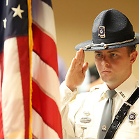 MDOT law Enforcement Honor Guard member Jesse James saluts the American flag during the National Anthem to unveiling the Cylde Whitaker Memorial Bridge sign at Tupelo City Hall Friday.