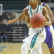UNCW's Kelva Atkins drives against Western Carolina Saturday November 29, 2014 at Trask Coliseum in Wilmington, N.C. (Jason A. Frizzelle)