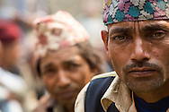 Homeowners from Dolakha, many who traveled over three hours by foot, lineup to receive the first installment, Rs 50,000 of the promised Rs200,000 to rebuild their homes, at a makeshift facility near the  Singati Bazaar in Dolakha, Nepal  April 13, 2016. Less than one-tenth of a percent, approximately 700 of the 770,000 owners of the affected households, have received cash grants from the government to rebuild their homes.  <br /> Gurkha was one of the hardest hit areas, including the Singati Bazaar, where over 100 bodies were buried under the ruble following the 7.8 magnitude April 25, 2015 earthquake and May 12th aftershock. Singati was the major market for residents of 21 Village Development Committees and many survivors of the April 25th earthquake were in the bazaar buying supplies when the aftershock hit causing a huge landslide.<br /> &copy; 2016 Michelle McLoughlin