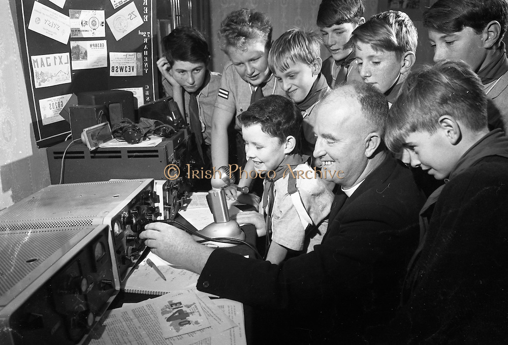 "Jamboree on the Air for Catholic Boy Scouts of Ireland. Picture shows Rev. Fr. James A. Stone, C.C. Donybrook, the well-known amateur radio operator, and National Organiser of the ""Jamboree on the Air"" for the Federation of Irish Scout Associations, calls ""C-O Jamboree"" assisted by Scouts and Macomh of his Donnybrook and Raheny units, Catholic Boy Scouts of Ireland..22.10.1966"