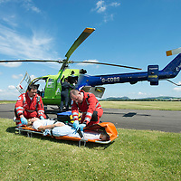 SCAA...Scotland's Charity Air Ambulance Paramedics Bruce Rumgay (right) and Alex Holden at work with a patient during an exercise...17.06.13<br /> Picture by Graeme Hart.<br /> Copyright Perthshire Picture Agency<br /> Tel: 01738 623350  Mobile: 07990 594431