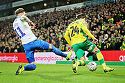 Norwich City midfielder Felix Passlack (24) just about to be fouled by Portsmouth midfielder Ronan Curtis (11) during the The FA Cup 3rd round match between Norwich City and Portsmouth at Carrow Road, Norwich, England on 5 January 2019.