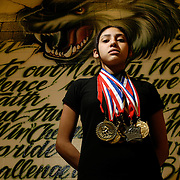 Alamo, TX / 2006 - Jennifer Gonzalez, 15, a PSJA Memorial High School sophomore, is a member of the school wrestling team and wrestles in the 95lb weight class. Photo by Mike Roy / The Monitor