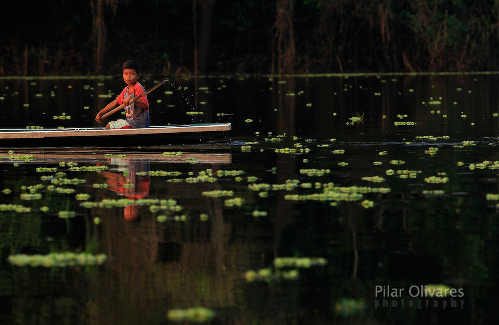 A boy rows a boat on a lake at Pacaya Samiria National Reserve in the Amazon jungle, September 3, 2011. REUTERS/Pilar Olivares....