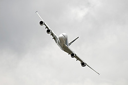 © London News Pictures. 09/07/2012. Farnborough, UK. A Malaysian Airlines Airbus A380 giving a flight demonstration on day one of the Farnborough International Airshow, in Farnborough, Hampshire, UK on July 9, 2012. FIA is a seven-day international trade fair for the aerospace industry which is held every two years at Farnborough Airport . Photo credit: Ben Cawthra/LNP.