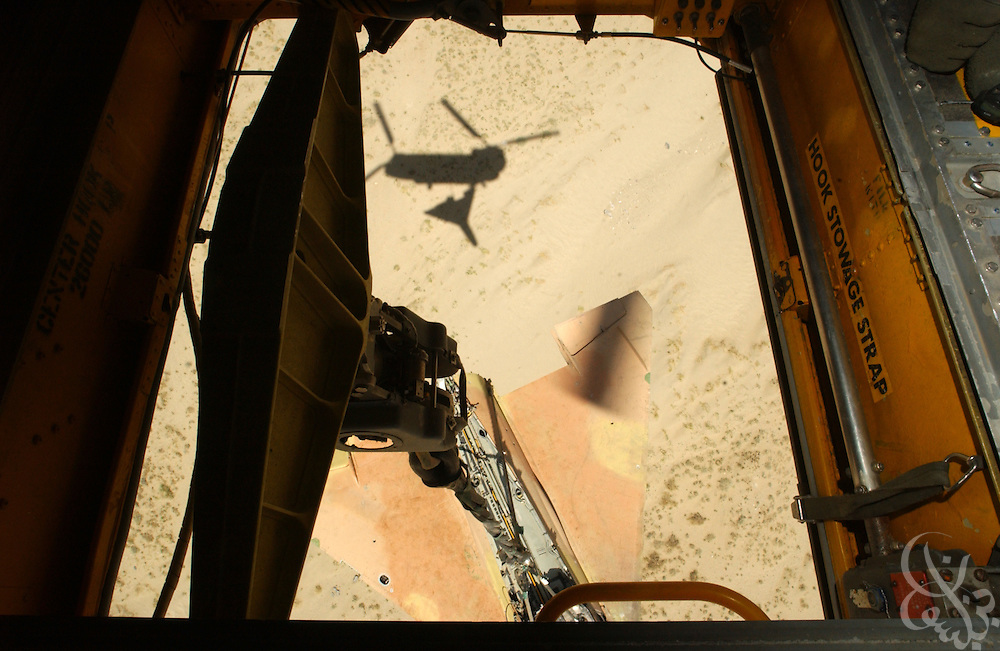 A U.S. Army CH-47 Chinook helicopter lifts the wrecked frame of a soviet MIG fighter jet as it participates in a mission to clear debris June 20, 2002 from the Bagram air base in Afghanistan.  Bagram, a former Soviet military base is littered with hundreds of wrecked vehicles and airplanes along with thousands of unexploded ordinance left over from the Soviet occupation of Afghanistan.