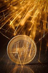 THEMENBILD - Euromuenze. Eine 1 Euro Muenze steht im Funkenschlag einer Wunderkerze. Aufgenommen am 16/11/2011 in Knittelfeld. EXPA Pictures © 2011, PhotoCredit: EXPA/ S. Zangrando